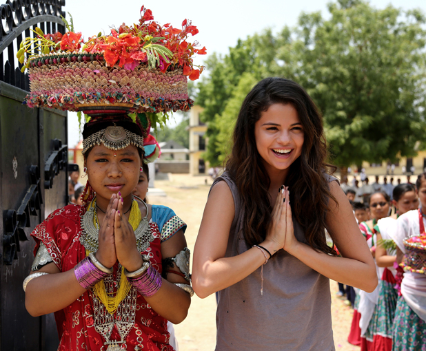 Selena Gomez visits Nepal in her role as UNICEF Ambassador, May 2014.Namaste! UNICEF Ambassador, Selena Gomez is greeted by students at Satbariya Rapti Secondary School wearing traditional Nepali clothing.