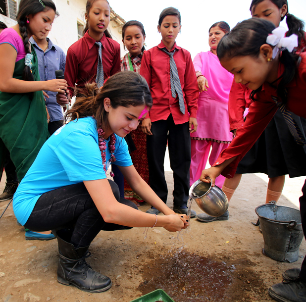Selena Gomez visits Nepal in her role as UNICEF Ambassador, May 2014.A group of adolescents perform a skit about the importance of sanitation facilities and proper hygiene practices in their communities and schools to prevent the spread of disease. The children called upon UNICEF Ambassador, Selena Gomez to demonstrate their proper hand-washing techniques.