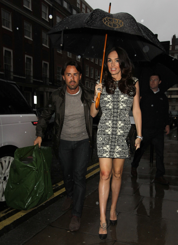 Tamara Eccelstone and Jay Rutland out and about keeping dry in the rain, London, Britain - 27 May 2014