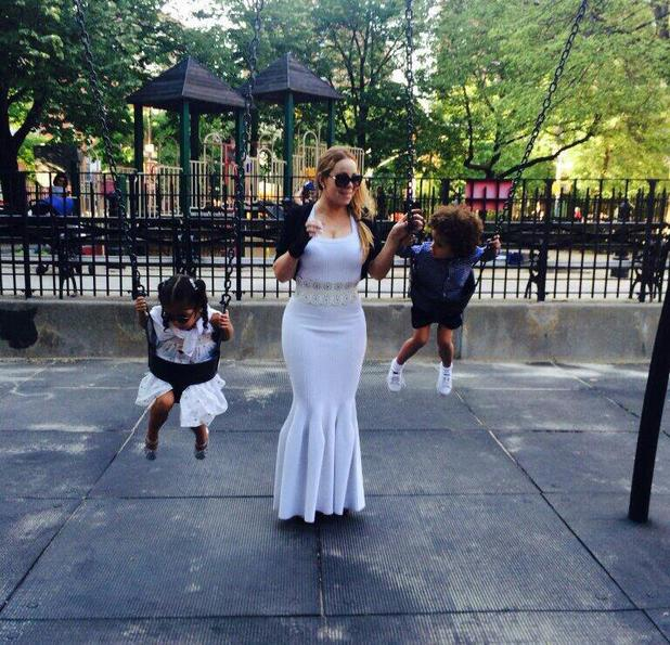 Mariah Carey takes twins to the park wearing a white fishtail gown (2 June).
