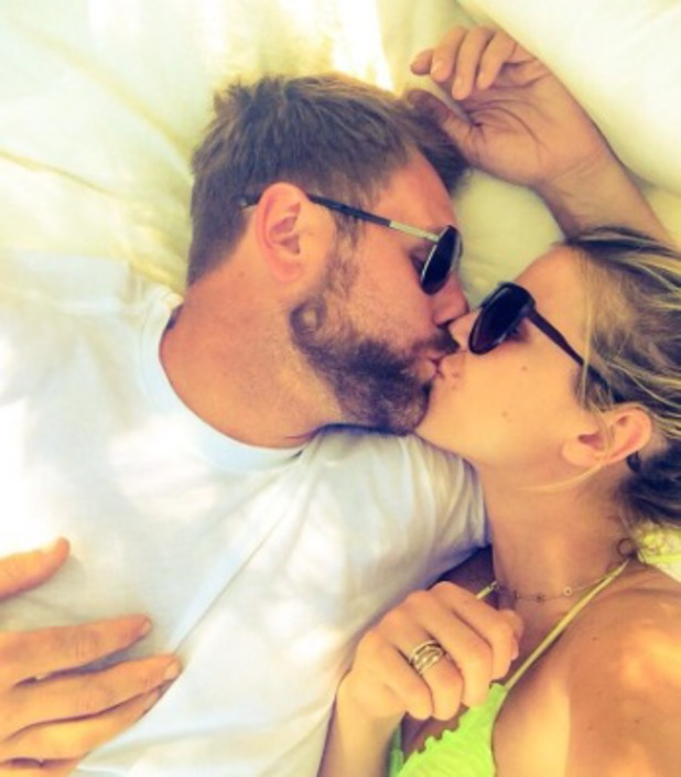 Vogue Williams and Brian McFadden kiss poolside, June 2
