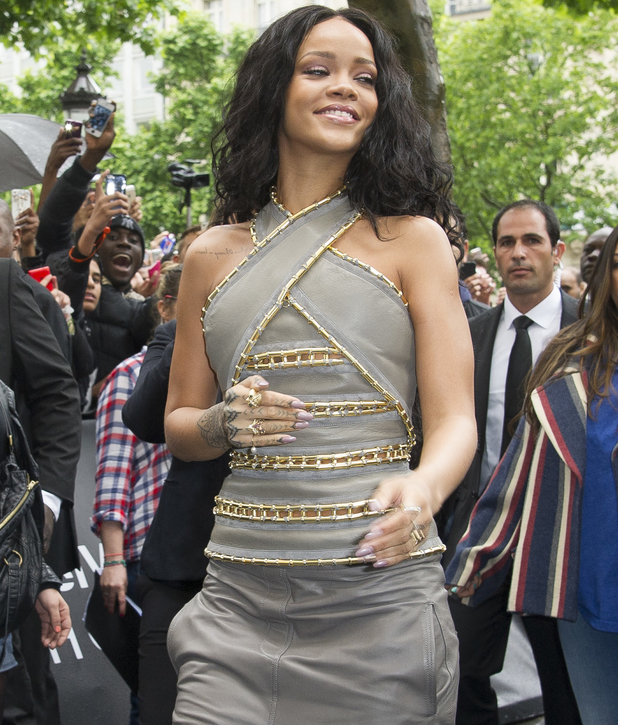 Rihanna attends the 'Rogue by Rihanna' launch in grey outfit at Sephora Champs-Elysees - 4 June 2014