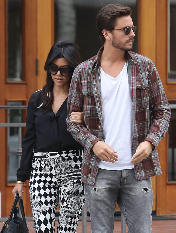 Kourtney Kardashian out and about in West Hollywood with Scott Disick carrying a drink from The Coffee Bean & Tea Leaf, 2013