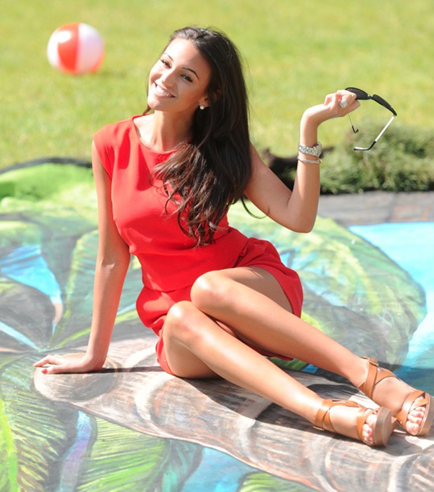 Michelle Keegan interacts with Virgin Holidays' piece of 3D artwork at Manchester's Hardman Square, which is of an imagined tunnel from Manchester to the alluring Caribbean island of Barbados. Picture date: Friday June 6, 2014
