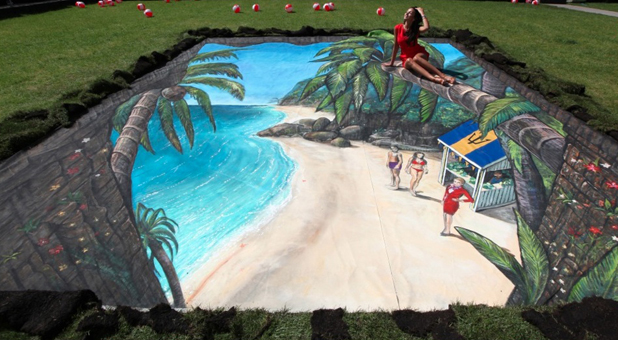 Michelle Keegan interacts with Virgin Holidays' piece of 3D artwork at Manchester's Hardman Square, which is of an imagined tunnel from Manchester to the alluring Caribbean island of Barbados. Picture date: Friday June 6, 2014.