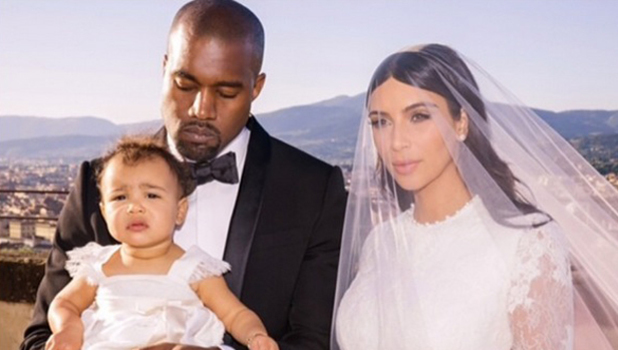 Kim Kardashian and Kanye West with daughter North on their wedding day in Florence, Italy on 24 May. Image released 11 June.