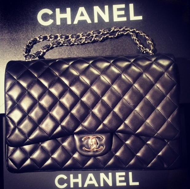 Paris Hilton shows off her new Chanel quilted handbag purchase in an Instagram picture - 10 June 2014