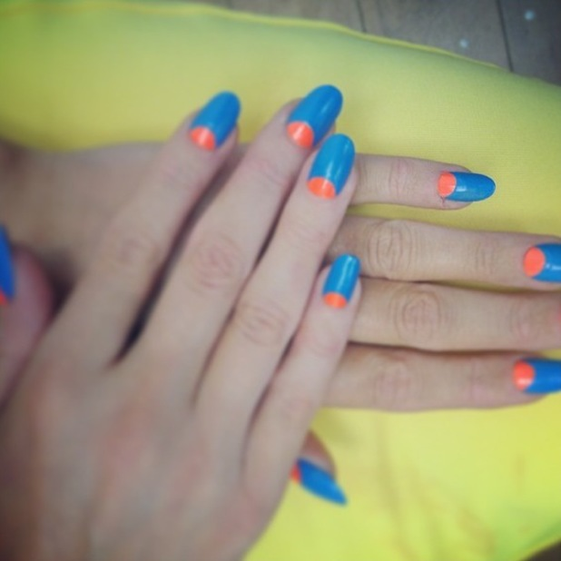 Laura Whitmore shows off her blue and neon orange half moon manicure in an Instagram picture - 6 June 2014