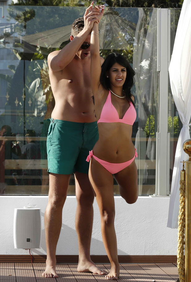 TOWIE's Jasmin Walia teaches Lewis Bloor some yoga moves poolside in Marbella, 9 June 2014