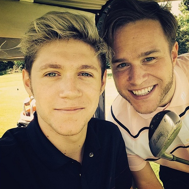 Niall Horan and Olly Murs enjoy a game of golf together, 12 June 2014