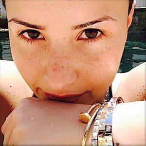 Demi Lovato shares make-up free selfie (17 June).