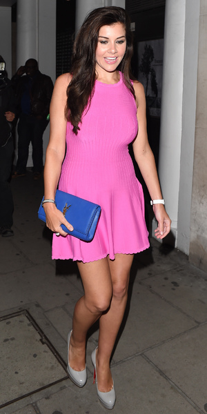 Imogen Thomas pictured leaving Nobu restaurant in Mayfair with a female friend wearing a bright pink dress, 21 June 2014
