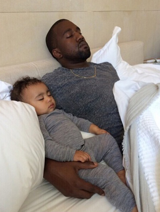 Kim Kardashian shares picture of Kanye West asleep with Baby North West in Soho on her Birthday, 15 June 2014