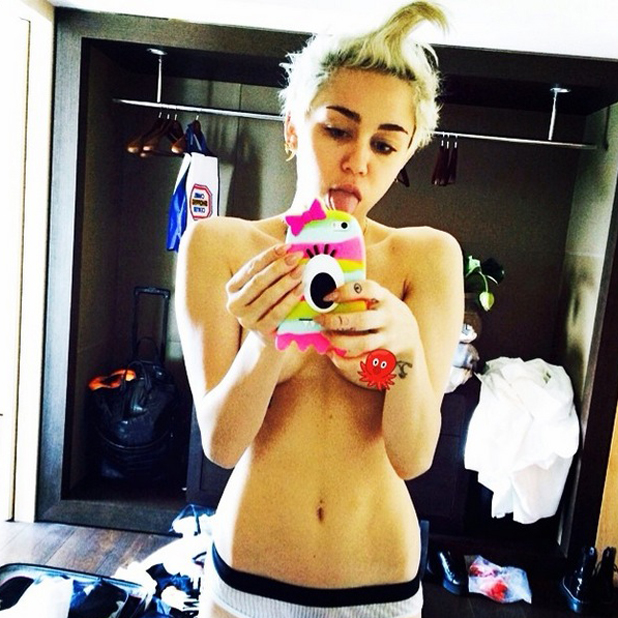 Miley Cyrus poses topless for a pre-shower selfie, 15 June 2014
