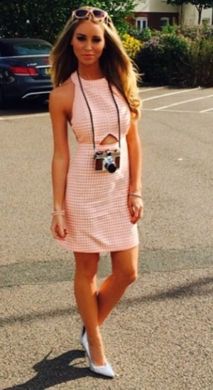 Lauren Pope poses in dress from own collection at Barbie-themed party (25 June).