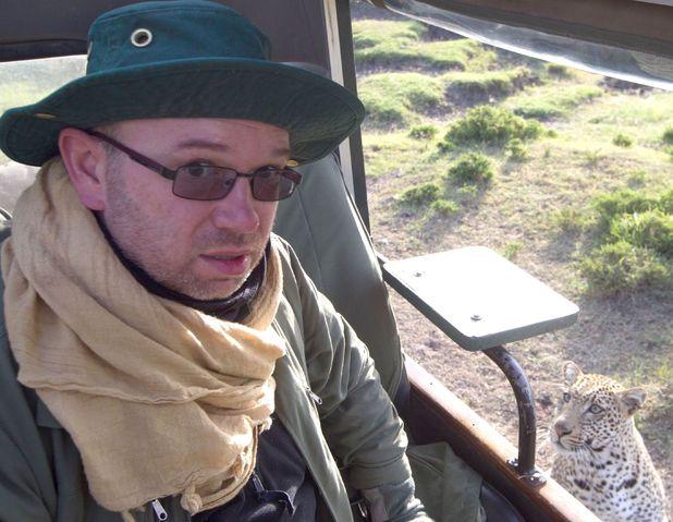 Tourist Gareth Owen meets a leopard on safari in Kenya