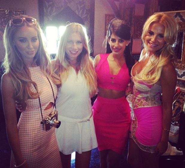 TOWIE's Lauren Pope poses in dress from own collection at Barbie-themed party (25 June).