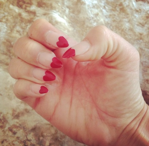 Lydia Bright shows off her love heart manicure, 24 June 2014