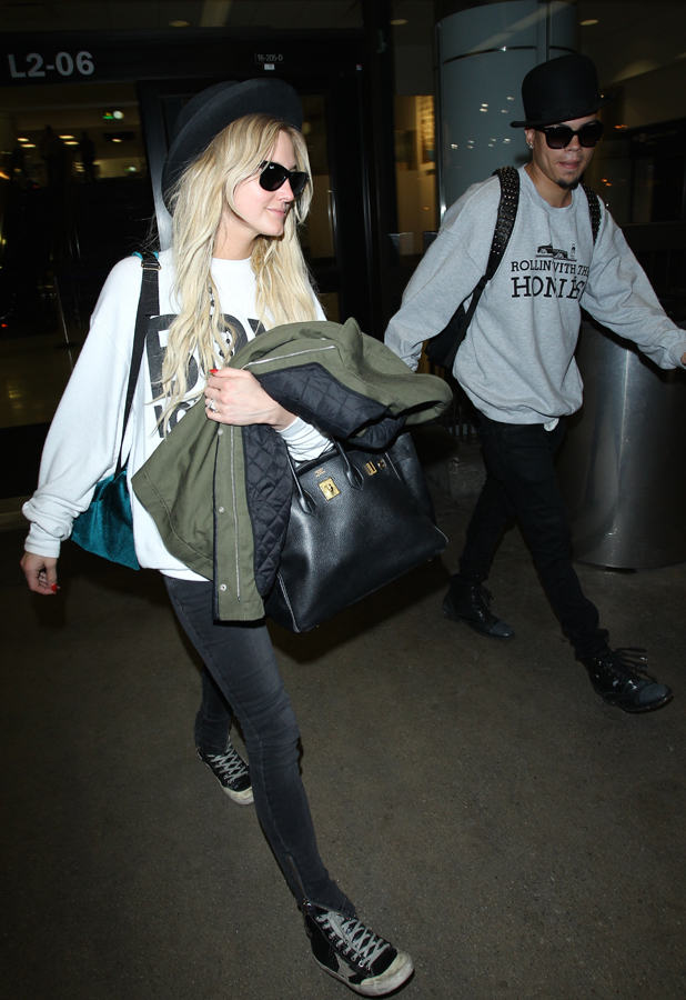 Ashlee Simpson and Evan Ross arrive at Los Angeles International Airport (LAX), 25 June 2014