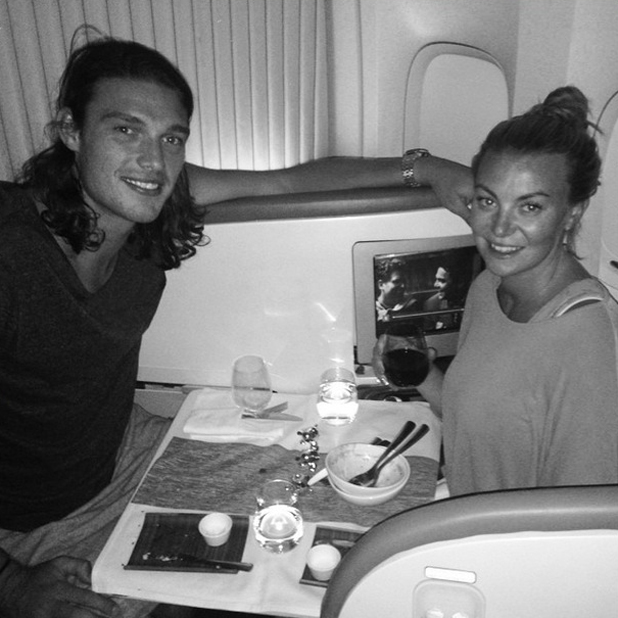 Andy Carroll and Billi Mucklow fly home to Essex from California, 27 June 2014