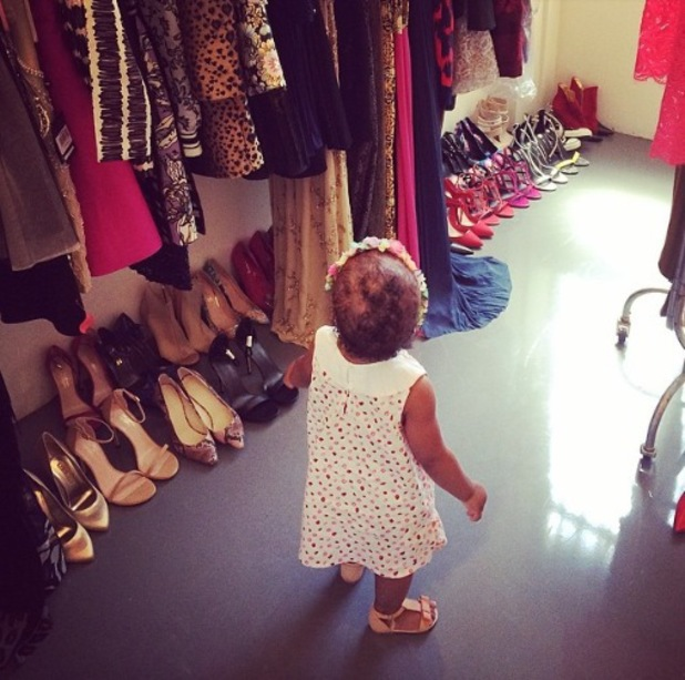 Rochelle Humes' daughter Alaia-Mai looks at clothes of a photo shoot - 4 July 2014
