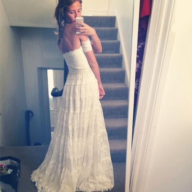 Millie Mackintosh poses for an Instagram picture wearing a wedding dress - 1 July 2014