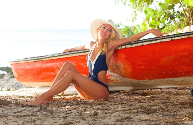 Kimberley Garner models her new summer '14 swimwear line for Kimberley London - July 2014