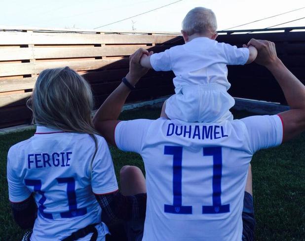 Fergie, Josh Duhamel poses in football shirt with son Axl (26 June 2014).