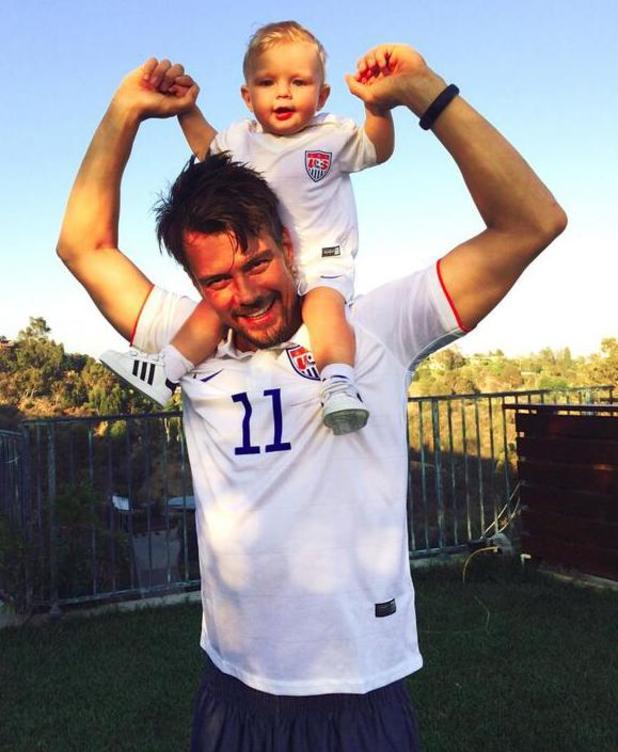 Josh Duhamel poses in football shirt with son Axl (26 June 2014).