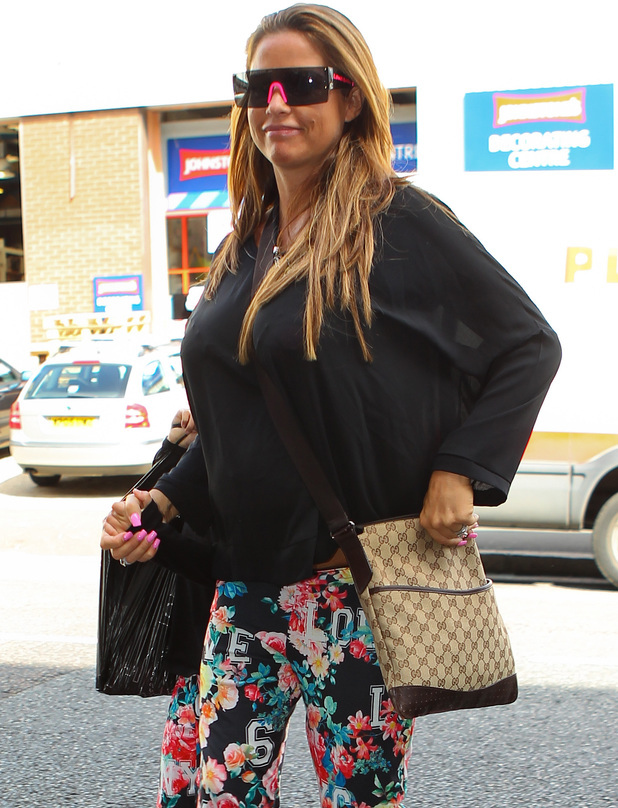 Katie Price and her daughter Princess Tiaamii arriving at Fubar Radio in London, wearing identical patterned trousers - 8 July 2014