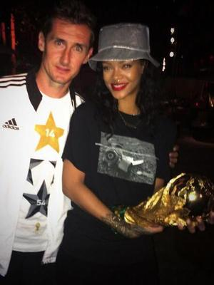 Rihanna poses with Miroslav Klose after Germany win the 2014 World Cup tournament (13 July).