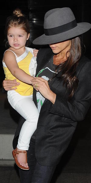 Victoria Beckham arrives at Los Angeles International (LAX) airport carrying daughter Harper, 18 July 2014