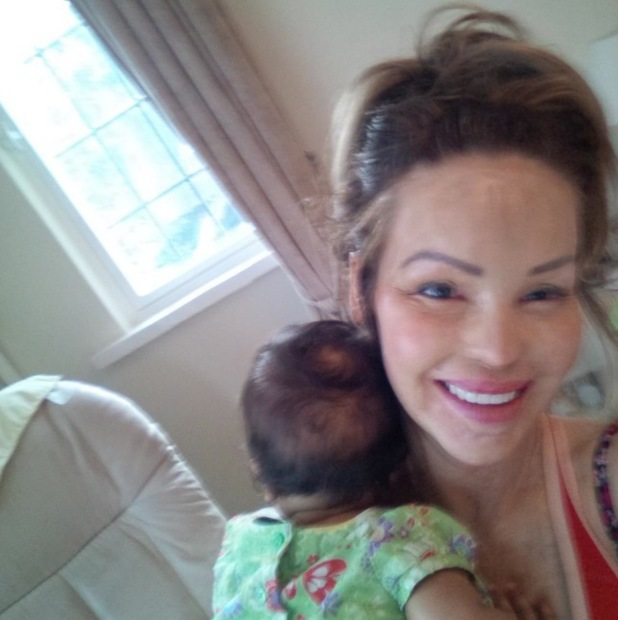 Katie Piper cuddles baby Belle after going for an evening run - 17 July 2014