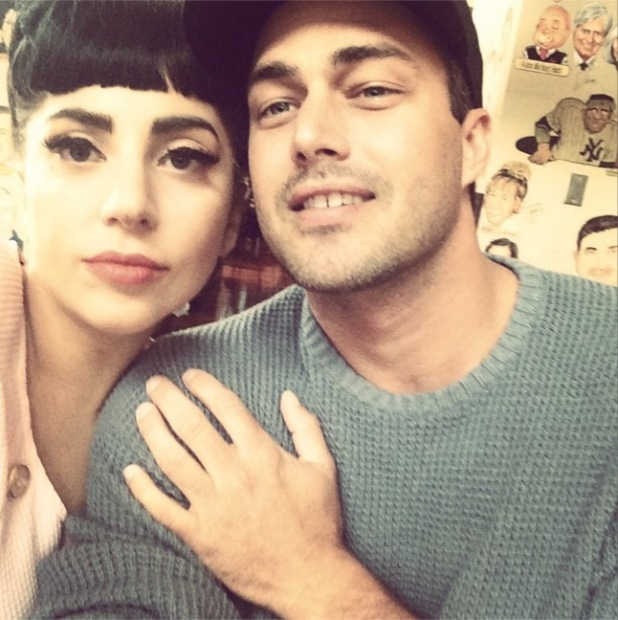 Lady Gaga cuddles up to boyfriend Taylor Kinney in cute photo (12 July).