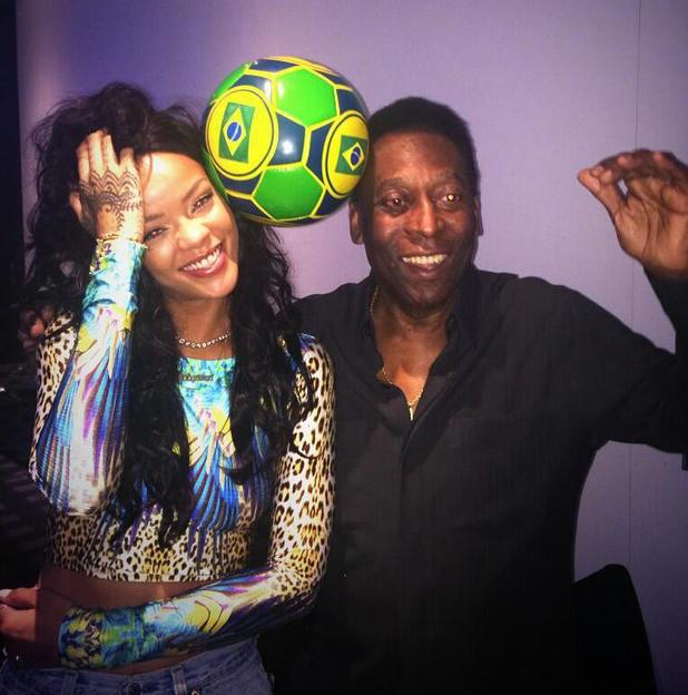 Rihanna hangs out with Pele ahead of the 2014 World Cup tournament in Brazil (13 July).