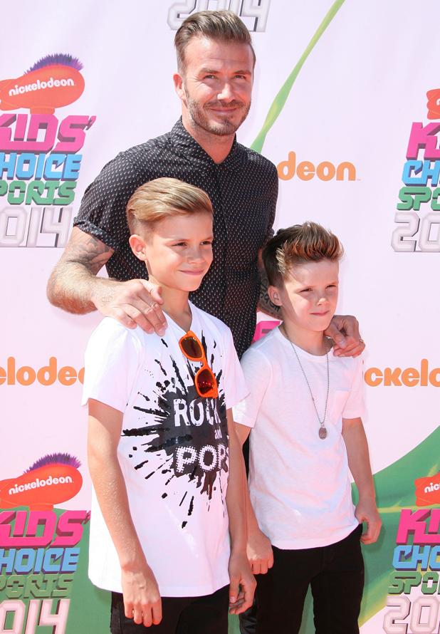 David Beckham with Cruz Beckham and Romeo Beckham at Nickelodeon Kids' Choice Sports Awards 2014 held at UCLA's Pauley Pavilion, LA 17 Jul 2014