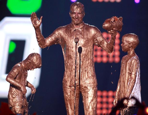 David Beckham (C) with Cruz Beckham (L) and Romeo Beckham (R) get slimed at the Nickelodeon Kids' Sports Choice Awards, LA 17 Jul 2014
