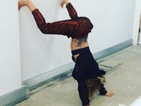 Cheryl Cole shows off back tattoo while twerking - upside down!