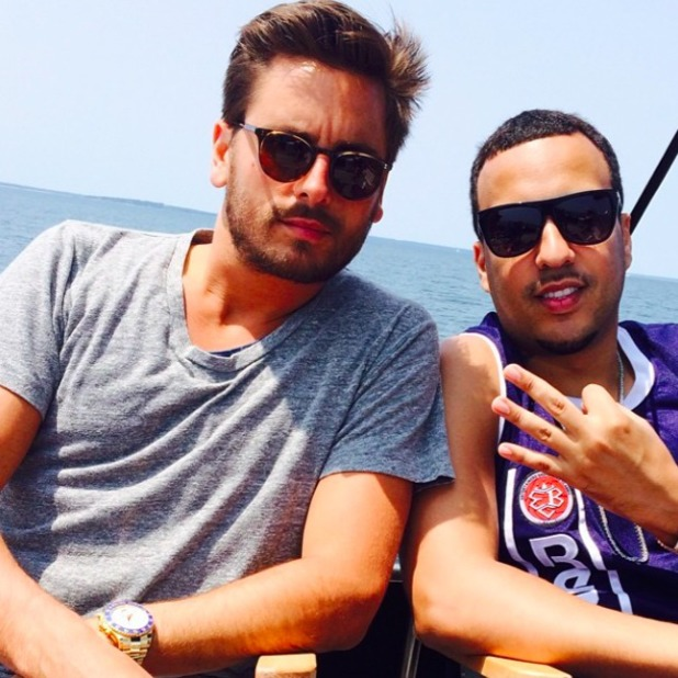 Scott Disick and French Montana enjoy a boat ride in the Hamptons - as you do! July 2014