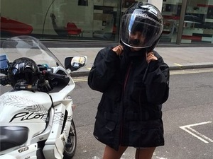 Frankie Sandford takes a speedy ride home on the back of a motorbike