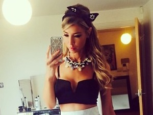 Lauren Pope does 1950s-inspired glamour in full skirt and frilly socks