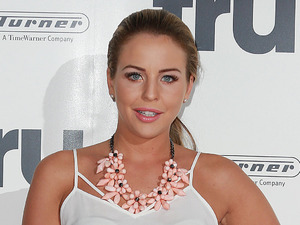 Lydia Bright pairs pink floral skirt with sheer cami at TV launch party