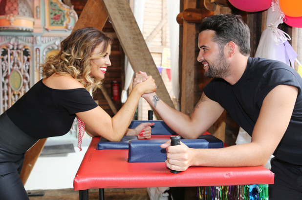 Jess Wright and Ricky Rayment arm wrestle at TOWIE's Grease-themed season finale party, Essex 27 July