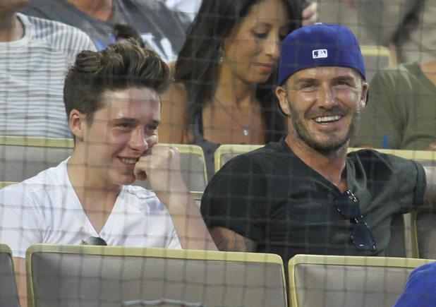 David Beckham watches the Los Angeles Dodgers v Atlanta Braves baseball game. 07/31/2014 Los Angeles, California, United States