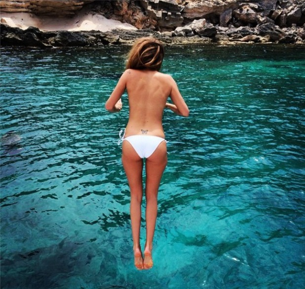 Millie Mackintosh goes topless in Formentera, 1 Aug 14.