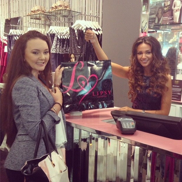 Michelle Keegan serves customers at the Lipsy store in Manchester, England - 1 August 2014