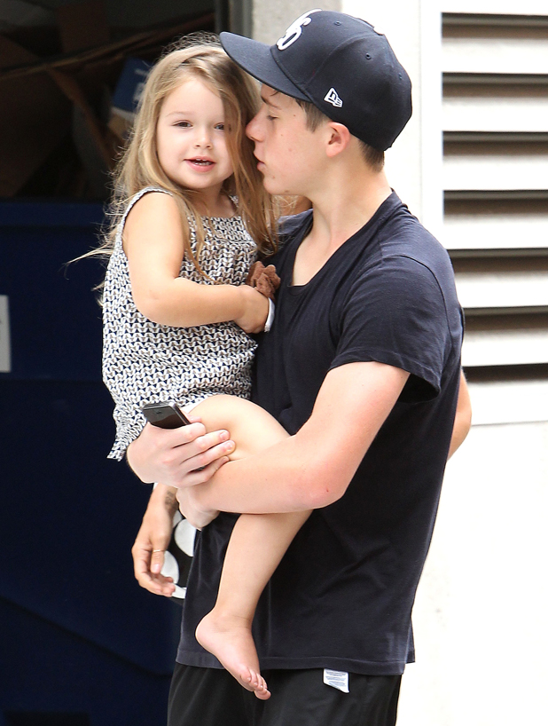 Brooklyn Beckham carrying sister Harper while leaving SoulCycle in Brentwood, California, America - 26 Jul 2014