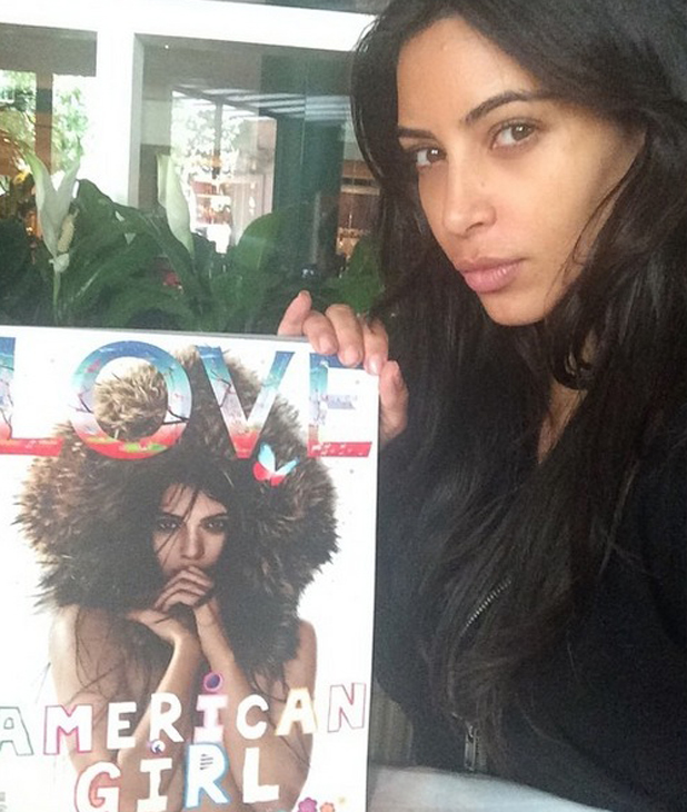 Kim Kardashian posts rare make-up free image while holding Kendall Jenner's Love magazine cover, 31 July 2014