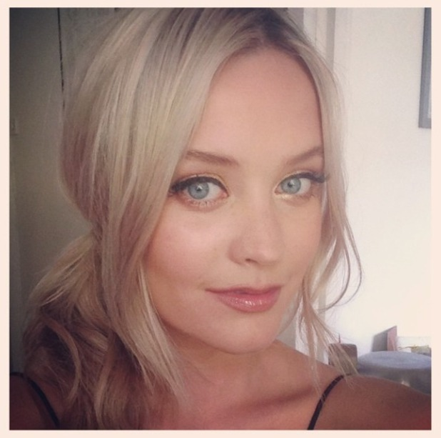 Laura Whitmore shows off a close-up of her make-up at The Expendables 3 film premiere, London, 4 August 2014