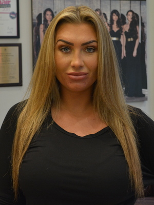 Lauren Goodger poses before having hair extensions applied at Inanch London - 11 August 2014